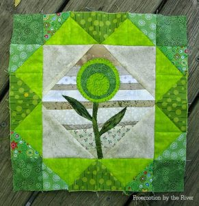 Green String quilt block with applique flower