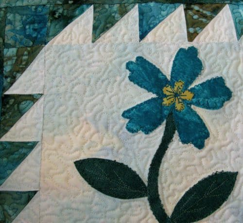 closeup of applique on quilted sizzix pillow