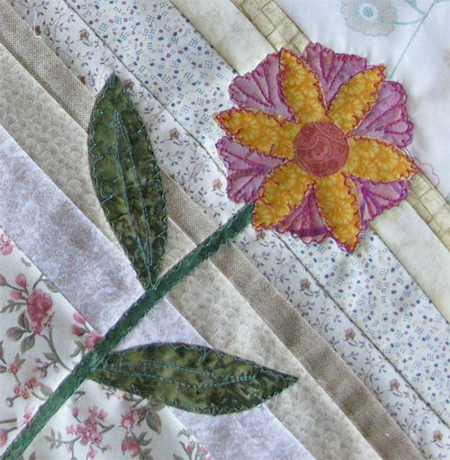 Applique flowers on string blocks