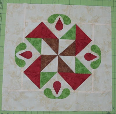 adding the appliqued flowers to the block