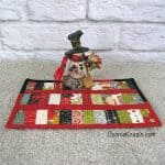 Scrappy Christmas Mug Rug tutorial made from leftover quilt scraps sewn together