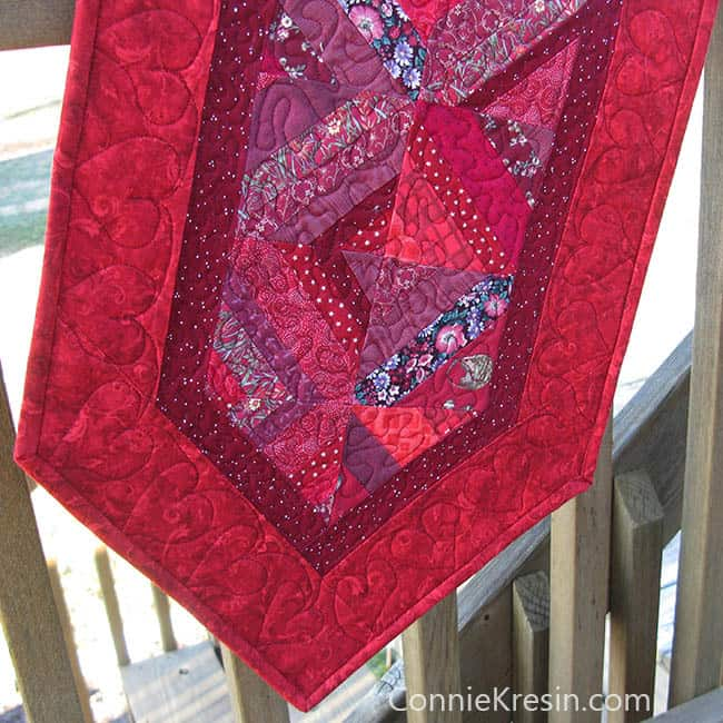 Red String table runner tutorial quilted and on deck rail