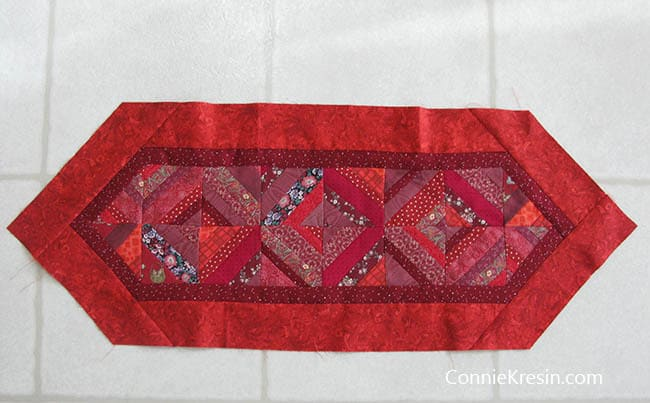 Red String table runner tutorial block layout with the final border on it