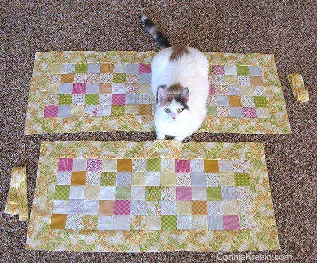 Orange Kissed Tablerunners tutorial fabric piecing the table runners and a cat on them
