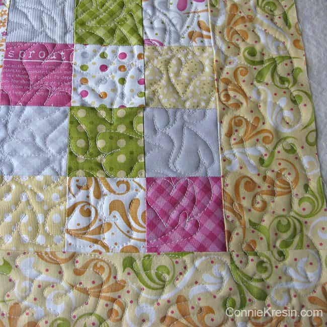 Orange Kissed Tablerunners tutorial fabric piecing the table runners closeup of quilting border