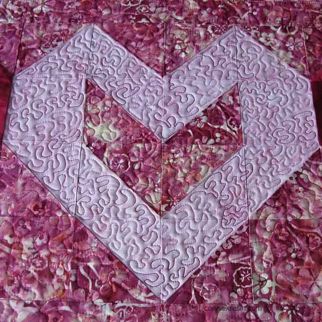 freemotion quilting on pink heart