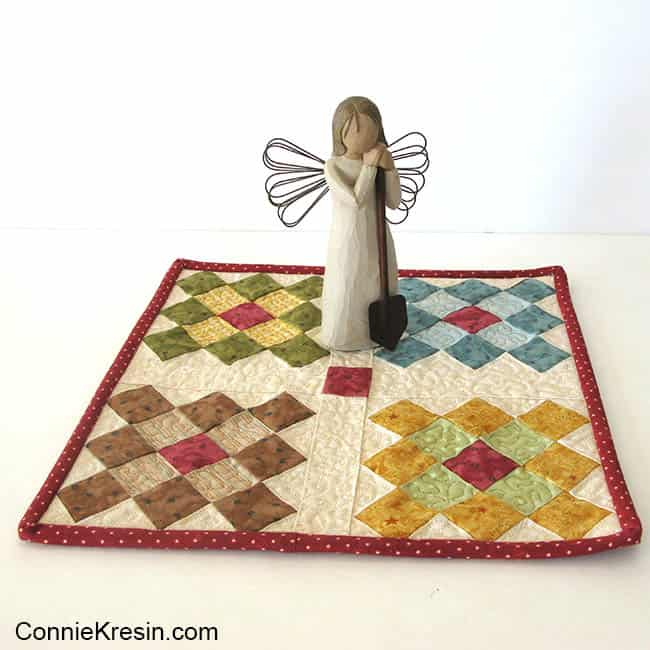 Easy to make Granny Square table topper with angel on it