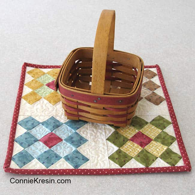 Easy to make Granny Square table topper with basket on it