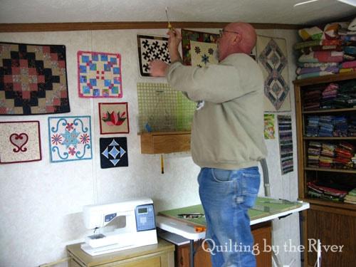 Builder Bob putting new lights in quilt studio