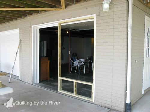 Builder Bob making screened garage door for cats