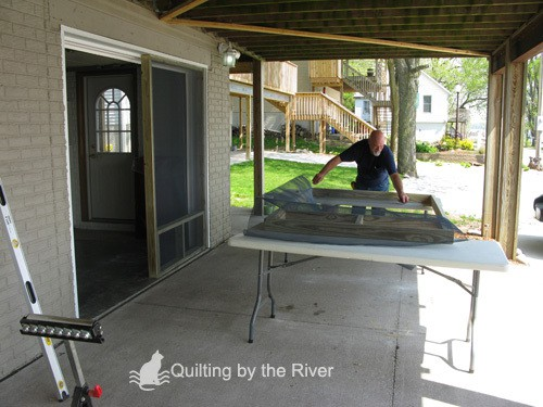 Builder Bob making screened garage door for cats