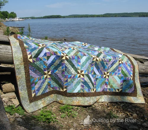 Intertwined jelly roll batik quilt