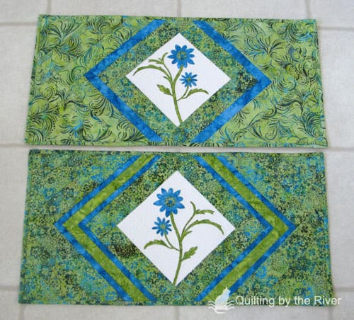 Free motion applique stitching on a batik table runner