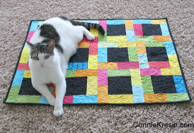Midnight Glow Quilt Tutorial quilt finished with a cat on it