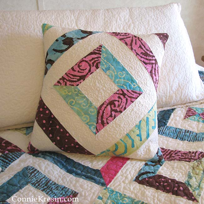 Beautiful quilt pillow made easily from batik strips of fabrics