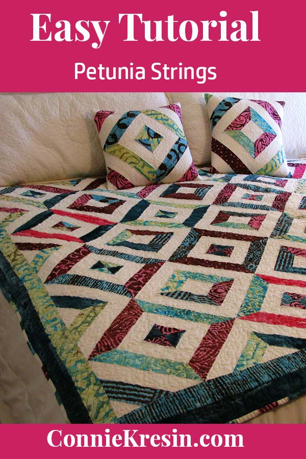 Petunia Strings quilt block pillow on bed