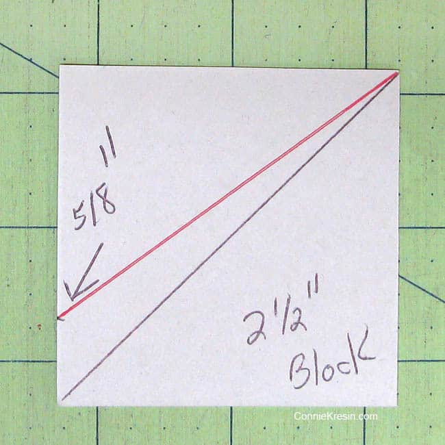 Swirly pinwheel quilt tutorial directions to cut the template from charm square cardboard cutting line