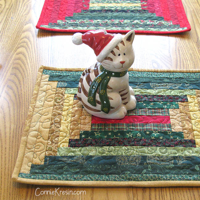 Christmas quilted log cabin placemats with a kitty cat