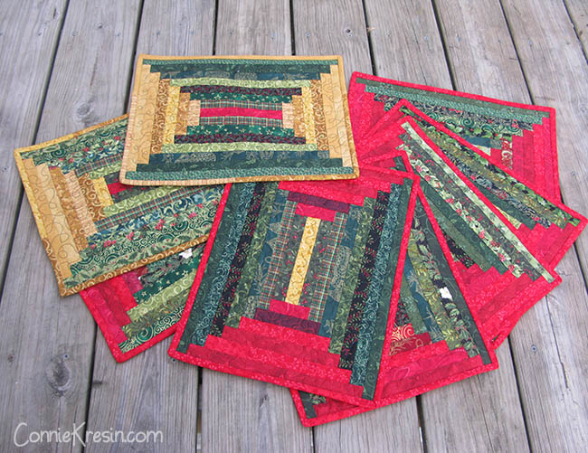 Christmas quilted log cabin placemats in a courthouse design
