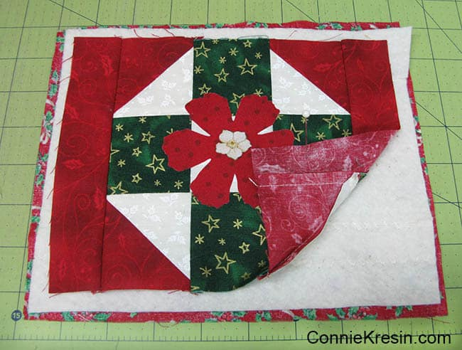 Christmas Mug Rug Tutorial added the batting and backing