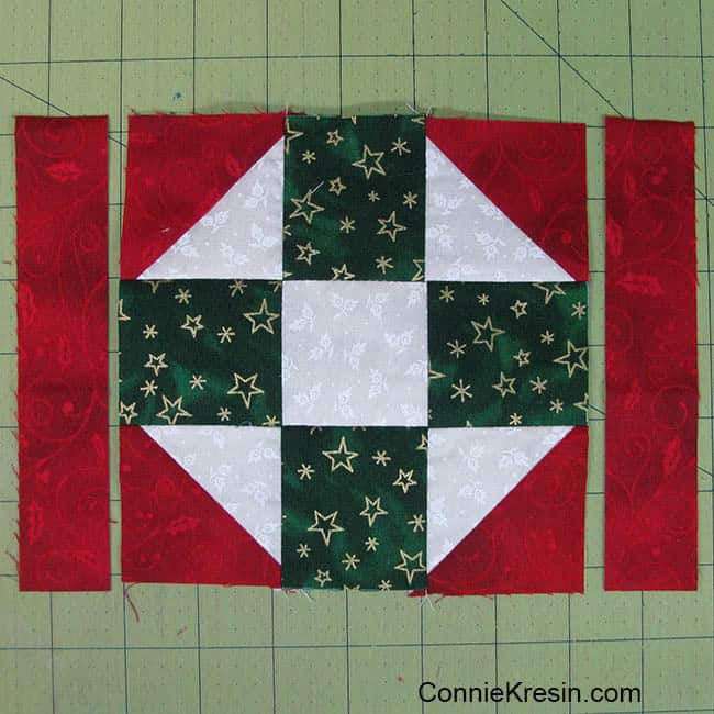 Christmas Mug Rug Tutorial add the side strips to widen the mug rug
