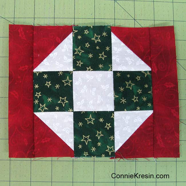 Christmas Mug Rug Tutorial added the side strips
