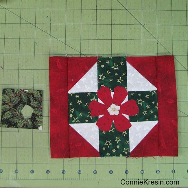Christmas Mug Rug Tutorial added the flower to the center