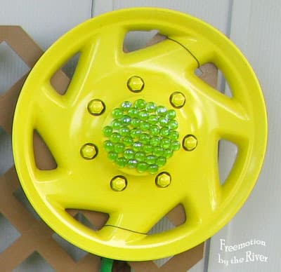 DIY Hubcap flowers for your garden with glass beads