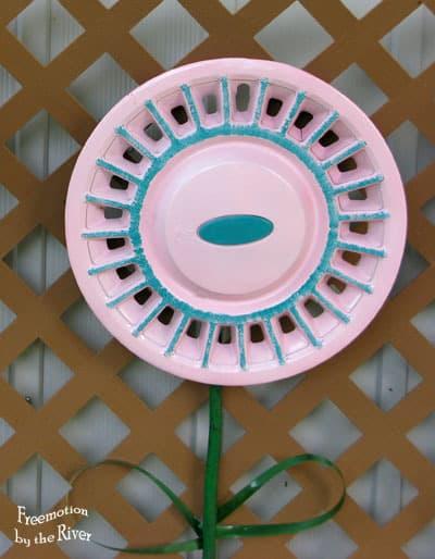 DIY Hubcap flowers for your garden sponge painted