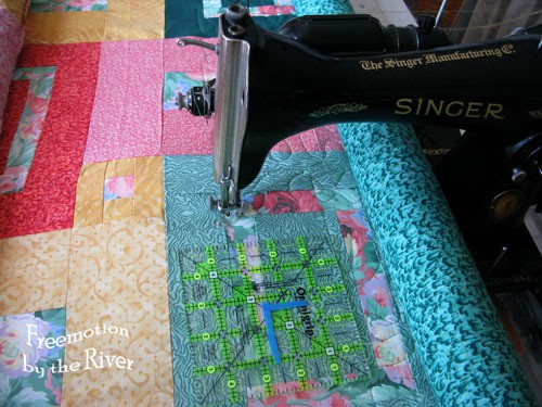 Quilt frame with a domestic vintage singer on it
