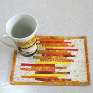 Mug rug tutorial made with tiny fabric strips with coffee cup
