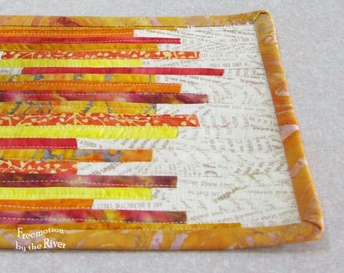 Mug rug tutorial made with tiny fabric strips closeup of quilting and binding