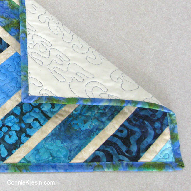 Broken Herring Bone quilt block table runner blue batiks binding stitched to front