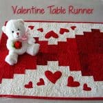 Valentine's Day table runner with a stuffed bear