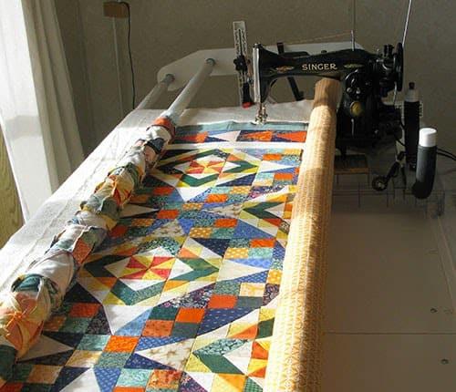 Celtic Solstice quilt on longarm frame