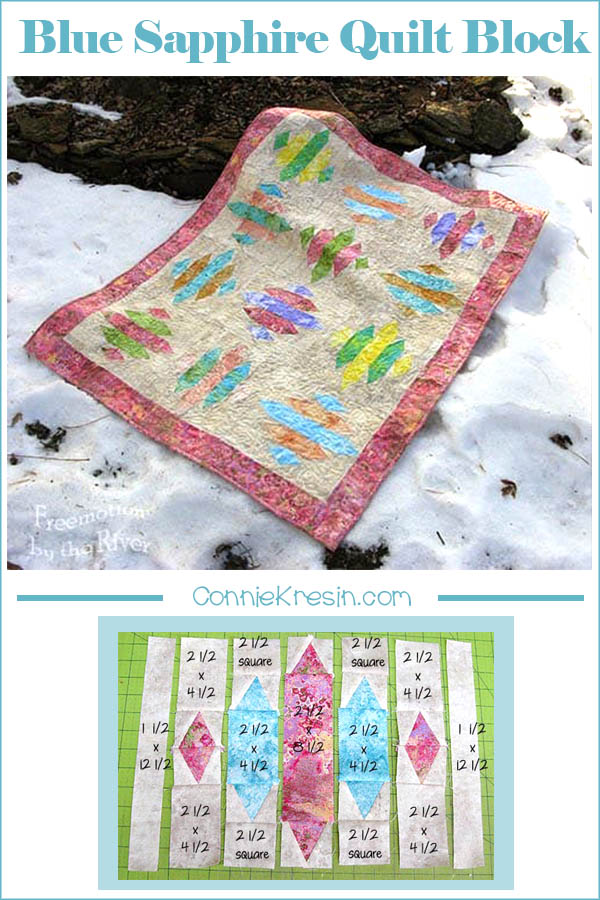 Marblehead baby quilt in the snow made with Blue Sapphire quilt pattern