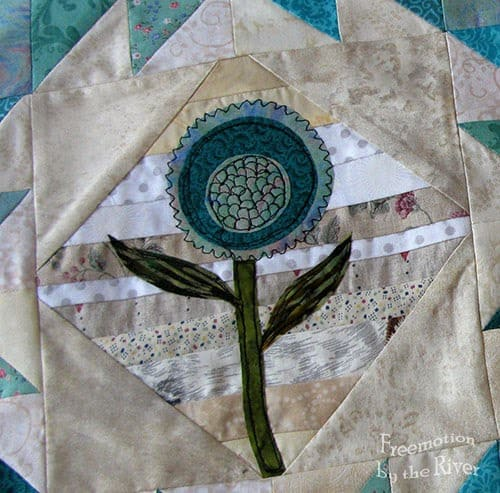 Teal Flower Block Tutorial flower with freemotion quilting on it