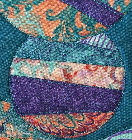 Closeup of freemotion quilting on the pillow center