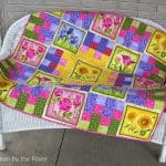 Summer Flowers quilt on bench