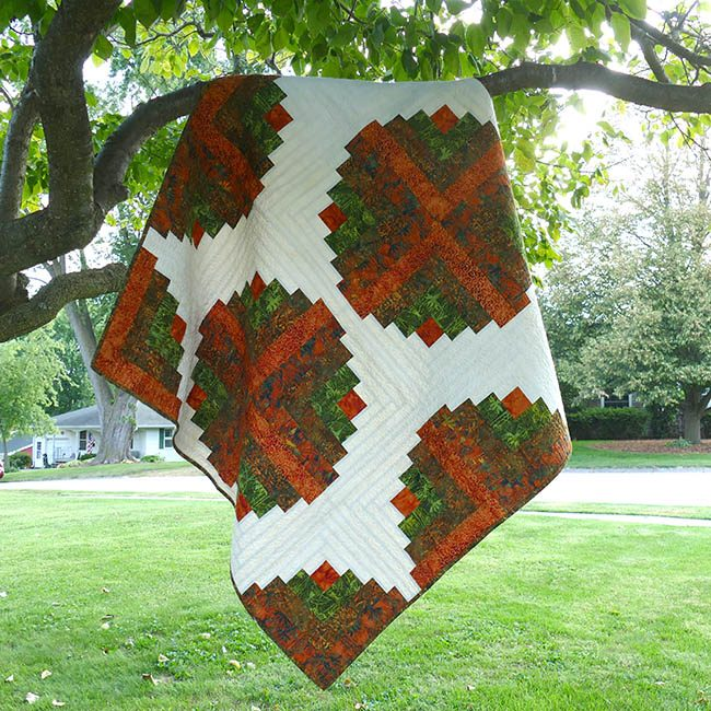 Amber Logs batik quilt pattern quilt hanging in tree