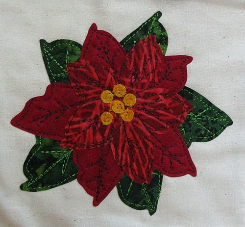 Seasons Greetings fabric poinsettia