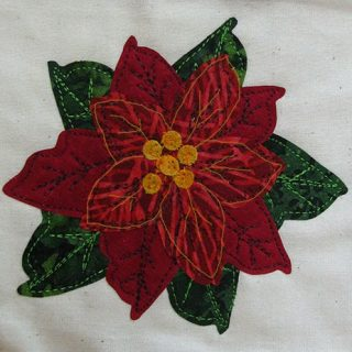 Seasons Greetings fabric poinsettia