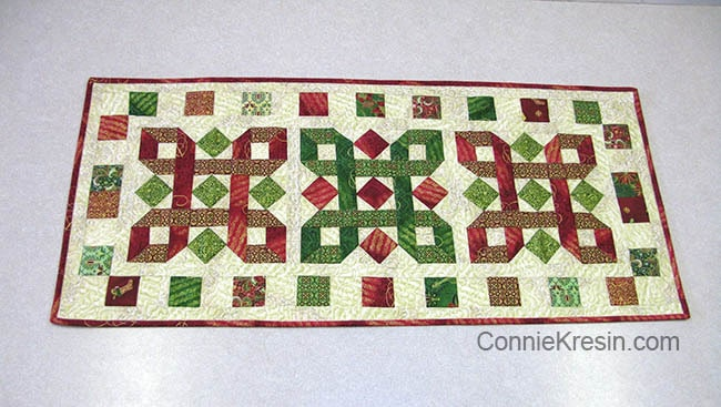 Christmas table runner tutorial  on kitchen counter