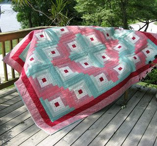 Log cabin quilt hand quilted