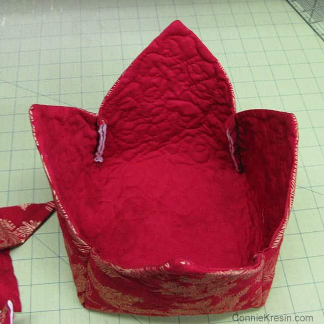 Fabric Basket tutorial 2 christmas fabrics inside of basket