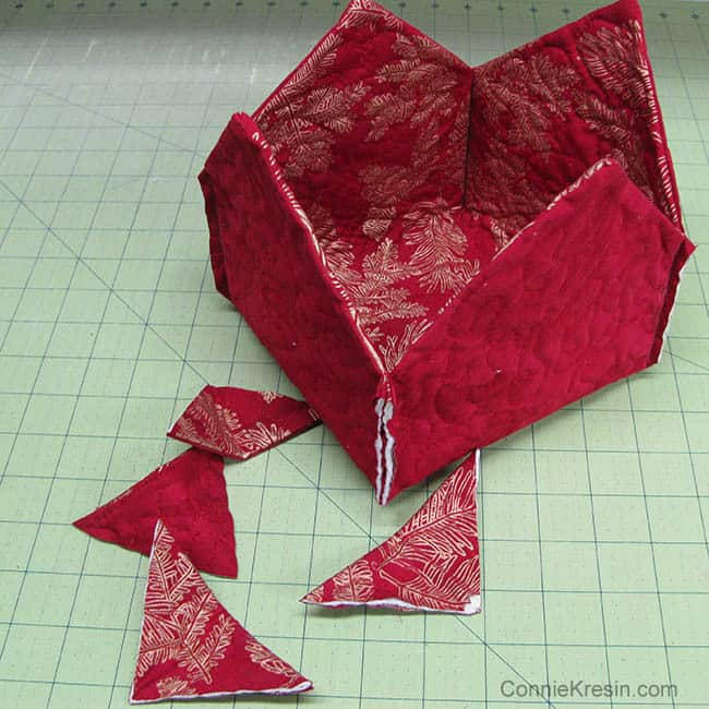 Fabric Basket tutorial 2 christmas fabrics 4 corners sewed and cut