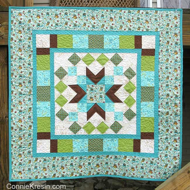 Whos Who quilted wall hanging tutorial on deck rail