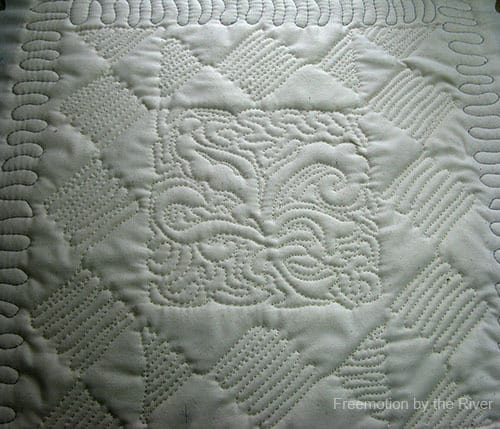 back of free motion quilted pillow at Freemotion by the River