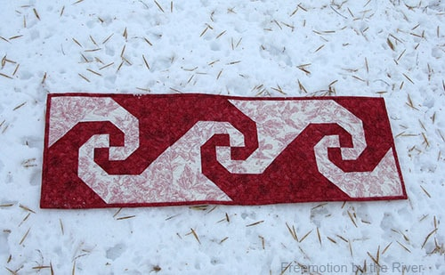 Red Snail Trail tablerunner in snow