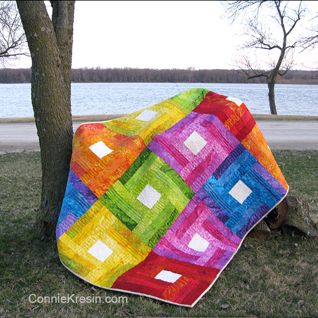 Rainbow Rail Fence baby quilt tutorial down by tree